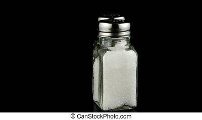 Salt shaker - Salt shaker on black Background.