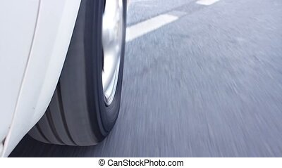 Rolling rubber tire of car on asphalt - Rolling rubber tire...