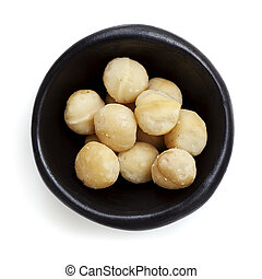 Macadamia Nuts in Black Bowl Overhead View Isolated on White