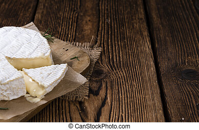 Camembert (close-up shot) on an old rustic wooden table