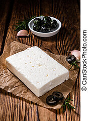 Fresh Feta Cheese detailed close-up shot on vintage...