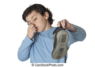 Child with a stuffy nose taking a boot isolated on white...