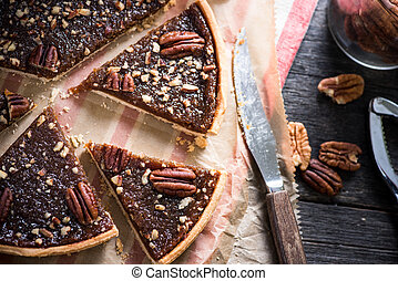 overhead view on pecan pie on baking sheet