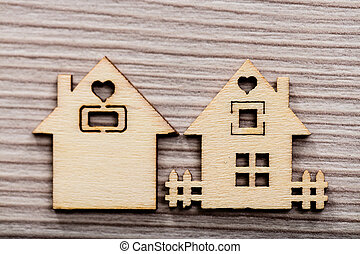 couple of little wooden houses 1 in focus - a couple of...