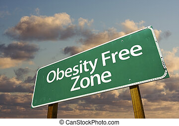 Obesity Free Zone Green Road Sign and Clouds - Obesity Free...