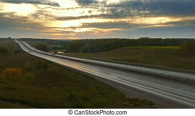 cars on highway road at sunset, timelapse - cars traveling...