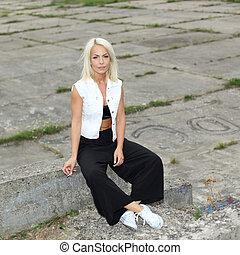 Close portrait of sexy fashion blonde who smokes a...