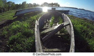 Boats on lake shore, 4K - Working and broken boats on lake...
