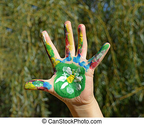 Painted kid hand with flower daisy