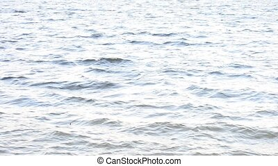 Wave-covered water surface. High key shot - Bluish and...