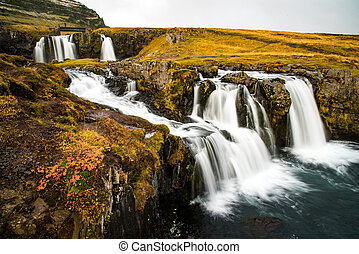 Waterfall near Kirkjufell, natural landmark of Iceland -...