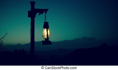 Lantern cinemagraph seamless loop - Lantern at twilight with...
