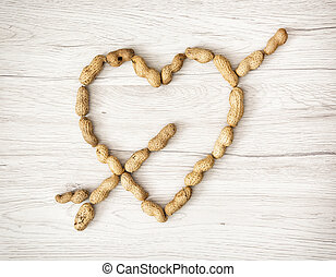 Heart of the peanuts on the wooden background, Valentine's...
