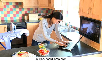 A woman working and cooking - Overwhelmed woman working and...