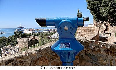 Telescope viewer overlooking the Alcazaba castle on...