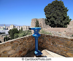 Telescope viewer overlooking the Alcazaba castle on...