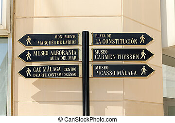 Street signs for tourists in Malaga, Andalusia, Spain