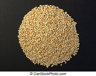 Sesame seeds - A heap of brown yellow sesame seeds