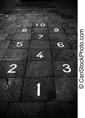hopscotch game on a sidewalk