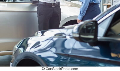 Salesperson representing a vehicle to his customer. -...