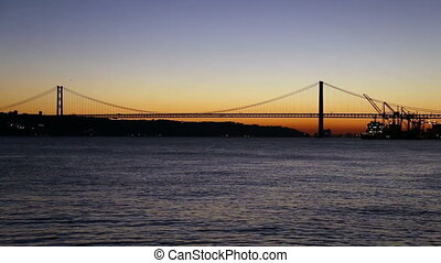 Sunset view of 25 de Abril Bridge - Sunset view of The 25 de...