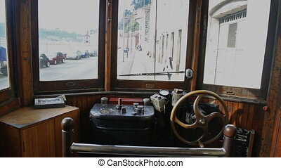 Inside view of Porto vintage train, moving by city street