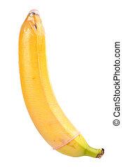 Condom on Banana - Close-up of banana with red condom...