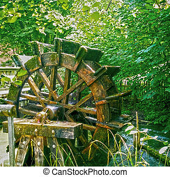 vintage water mill wheel running - vintage wooden mill wheel...