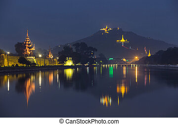 mandalay - Night view of Mandalay cityscape with famous Fort...
