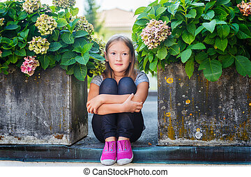 Fashion portrait of a cute little girl of 7-8 years old,...