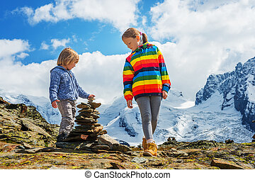 Cute little kids resting in Gornergrat glacier, Switzerland,...