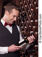 Attractive young sommelier is working with joy - Cheerful...