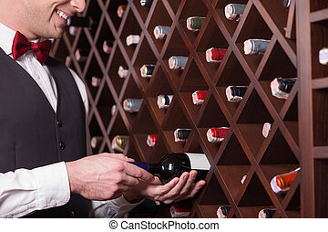Skillful waiter is working in a restaurant - Close up of...