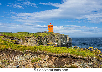 Orange lighthouse at the cost of Grimsey island nearby...