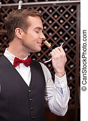 Attractive male wine waiter with a bottle-screw - Cheerful...