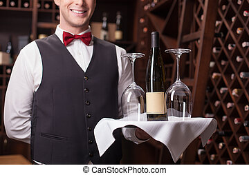 Cheerful male waiter is working in winehouse - Skillful...