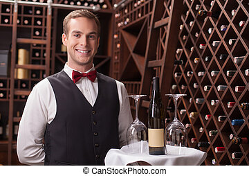 Attractive young sommelier is working in restaurant -...