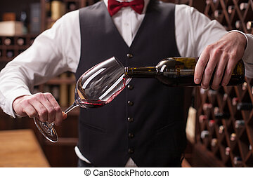 Cheerful male waiter is serving alcohol drink - Close up of...