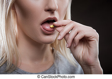 Depressed young female druggie is receiving ecstasy - Close...