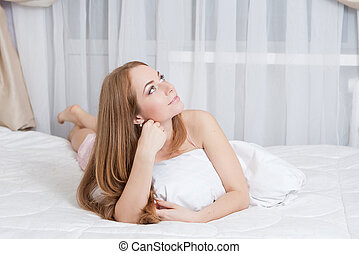 Woman lying at bed