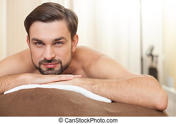 Handsome guy is relaxing at beauty salon - Cheerful young...