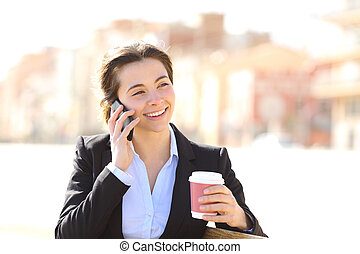 Business woman on the phone in a park