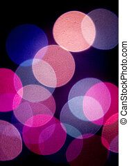 Colored defocused party lights at night abstract photo on...