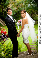 Couple Getting Married - An attractive young bride and groom...