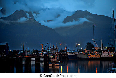 Misty Mountain Harbor - Evening view of small harbor tucked...