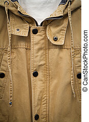 Brown autumn cotton jacket. closeup. texture button