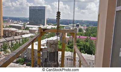 Climbing Up on a Construction Cradle - climbing up on a...