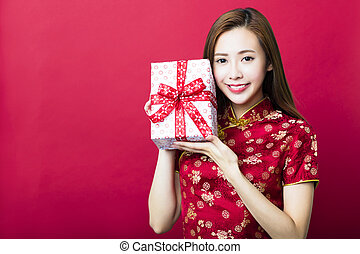 happy chinese new year.young woman holding gift box