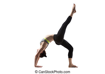 One-legged Wheel Pose - Sporty beautiful young brunette...