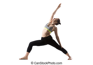 Reverse Warrior Pose - Portrait of sporty beautiful young...